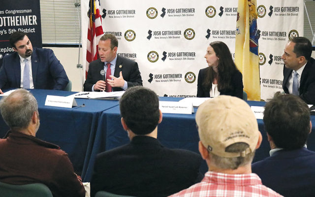 From left, Jared Maples, director of the New Jersey Office of Homeland Security and Preparedness; Representative Josh Gottheimer (D-5th Dist.); FBI intelligence analyst Carly Rasiewicz, and FBI Special Agent Anthony Zampogna participate in a panel discussion on synagogue safety on June 12 in Paramus.  (Josh Gottheimer)