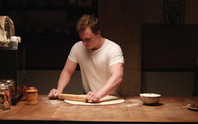 """Tim Kalkhof as Thomas prepares dough in a scene from """"The Cakemaker."""""""