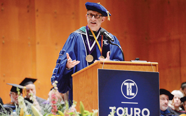 Dr. Alan Kadish congratulates the students at the Touro Colleges commencement. (Courtesy Touro)