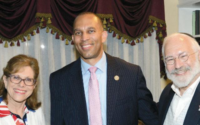 Chana and Len Grunstein with Representative Hakeem Jeffries. (Courtesy Norpac)
