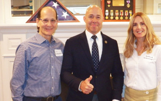 Phil and Rochelle Goldschmiedt flank Congressman Brian Mast. (Courtesy Norpac)