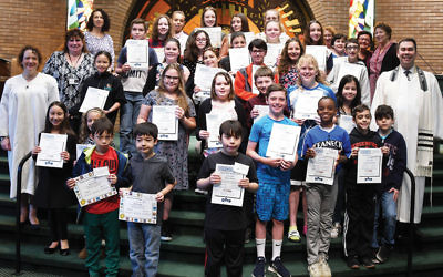 Cantor Ellen Tilem, school director Dora Geld Friedman, and Rabbi Steven Sirbu, join students and teachers at a moving up ceremony at Temple Emeth in Teaneck. Students come from Bergenfield, Teaneck, New Milford, Oradell, Hackensack, Fort Lee, and Englewood. (Barbara Balkin)