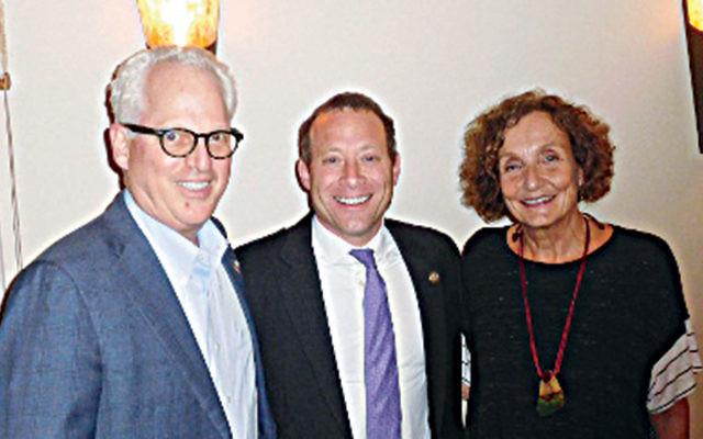 Dr. Robert and Sarah Goodman flank Josh Gottheimer at a Norpac gathering. (Courtesy Norpac)