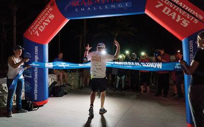Marathon man Bret Parker, who has Parkinson's disease, wills himself across the finish line during the final race. (Melina Mara)