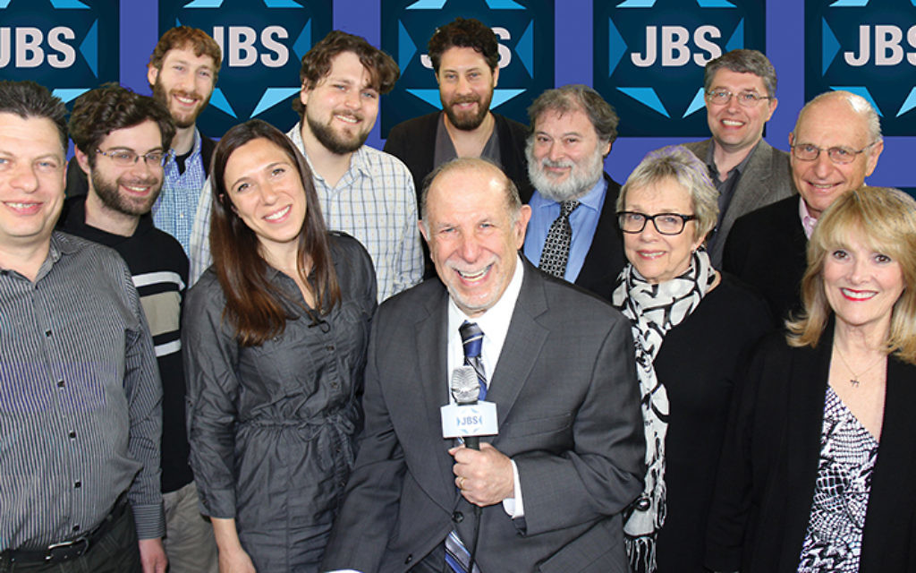 Rabbi Mark Golub, center, is surrounded by Jewish Broadcasting Service staff members.
