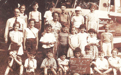 Miriam Dubi-Gazan, sitting, right, poses with classmates at the Rosj Pina Jewish elementary school in Amsterdam on June 25, 1953. (Photos Courtesy of Dubi-Gazan)