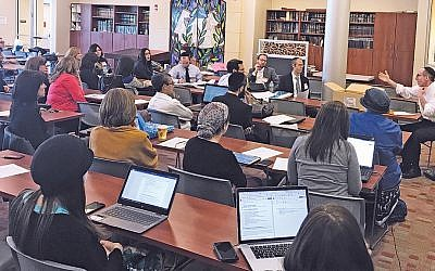 "Rabbi Howard Jachter leads a session, ""Teaching Emunah to Modern Orthodox High School Students,"" at the YHShare conference for modern Orthodox educators. (N. Aaron Troodler)"