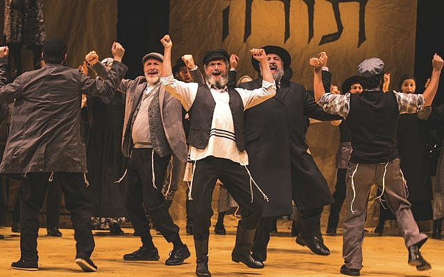 "Steven Skybell is Tevye in the Folksbiene's Yiddish ""Fiddler."" Torah's in the background."