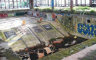 The once majestic indoor pool lies in ruins at Grossinger's.