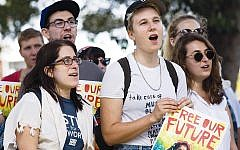 Rabbi Rachel Kahn-Troster, left, at the protest in San Diego. (Photos courtesy Bend The Arc)