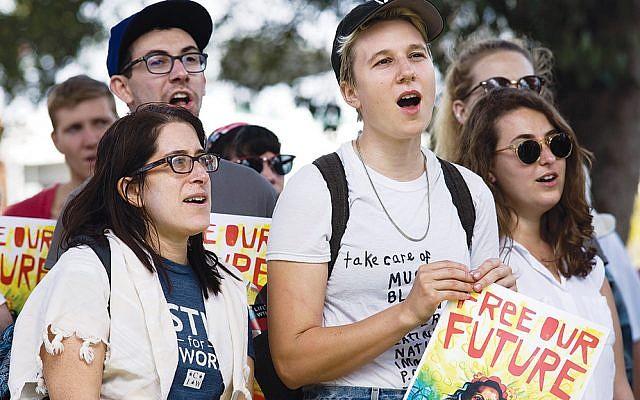 Rabbi Rachel Kahn-Troster, left, at the protest in San Diego. (Photos courtesy Bend The Arc)