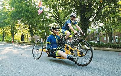JJ Eizik from Monsey rides Bike4Chai on an adaptive hand cycle. (Courtesy Bike4Chai)