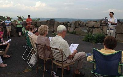 Rabbi David Widzer of Beth El leads a previous Palisades service. (Photo provided)