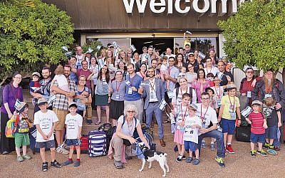 Olim from the July 3 flight gather for a group photo. (Photos by Ben Kelmer)