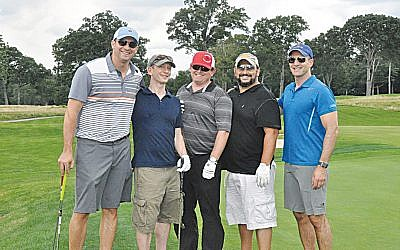 Attendees enjoy a round of golf at last year's Moriah summer outing. (Courtesy Moriah)