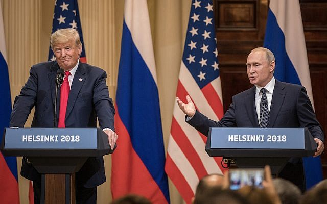 HELSINKI, FINLAND - JULY 16:  U.S. President Donald Trump (L) and Russian President Vladimir Putin answer questions about the 2016 U.S Election collusion during a joint press conference after their summit on July 16, 2018 in Helsinki, Finland. The two leaders met one-on-one and discussed a range of issues including the 2016 U.S Election collusion.  (Photo by Chris McGrath/Getty Images)