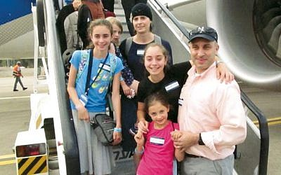 Tzipora and Rabbi Menahem Meier's daughter, son-in-law, and grandchildren walk off the plane to their new lives in Israel. (Courtesy Menahem Meier)