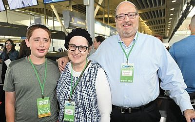 At the airport, Rabbi Kenneth, Ruchie, and Yitzchak Brander are ready to board Nefesh B'Nefesh's flight to Israel. (Nefesh B'Nefesh)