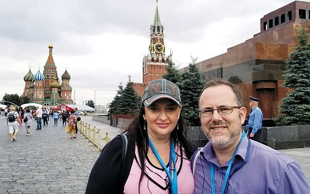Rabbi David Fine and his wife, Alla Fine, stand in front of the Kremlin during a sightseeing break from a conference on Jewish law at Moscow State University.