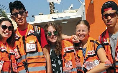 Rescue Israel campers wear the orange vests of United Hatzalah while they train as medical first responders.