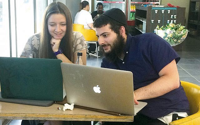 Bar-Ilan University summer lab partners Mark Kaplan of Woodcliff Lake and Chana Tropp of Teaneck work together.