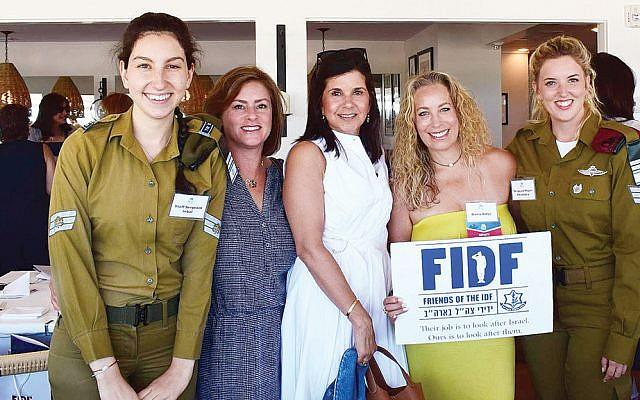 Staff Sgt. Inbal, left, with Amy Sprung, Erica Donner, Dana Adler of Tenafly, and Sgt. Maj. Alexandra. (Courtesy FIDF)
