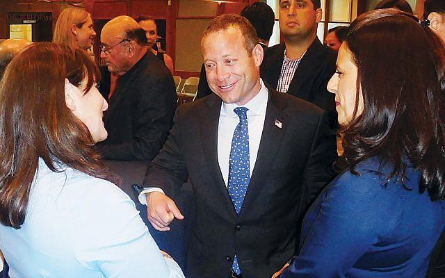 Sarah Paley, left, Representative Josh Gottheimer, and Miriam Pfeiffer at bergenPAC (Photos courtesy Norpac)