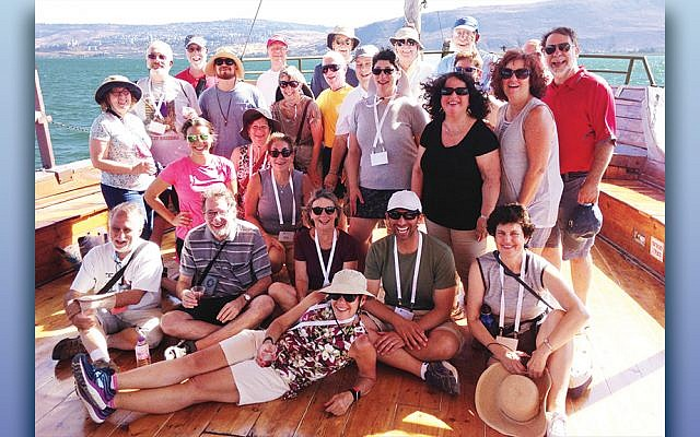 Temple Avodat congregants on a boat in the Galilee. Rabbi Paul Jacobson is seated, second from right, with white hat.