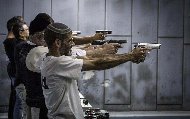 Israelis firing at a shooting range in Jerusalem, Oct. 15, 2015. (Ilia Yefimovich/Getty Images)