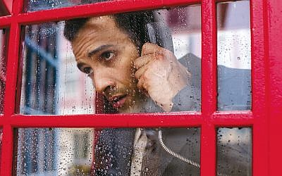 Ashraf Marwan — played by Marwan Kenzari — calls the Israeli Embassy in London. (Photos by Netflix)
