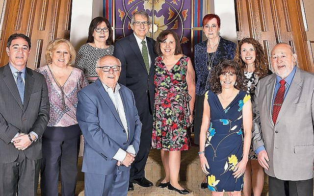 Rabbi Ronald and Rhonda Roth, center, with gala committee members. (Courtesy FLJC)