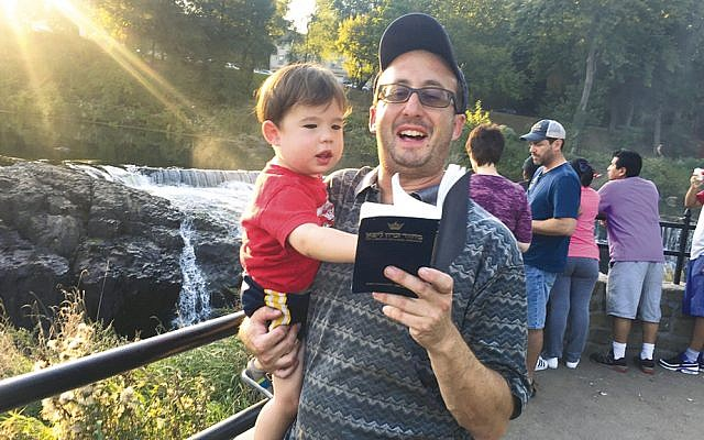 Father and son celebrate at last year's Tashlich at the Great Falls. (Courtesy Jerry Schranz)
