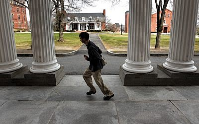 The Tufts University campus in suburban Boston has more than 5,500 undergraduates and 6,000 graduate students. Here, a student sprints across campus. (David L. Ryan/The Boston Globe via Getty Images)