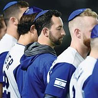 Team Israel players lining up for the national anthem prior to the World Baseball Classic game against the Netherlands in Tokyo, March 13, 2017. (Matt Roberts/Getty Images)