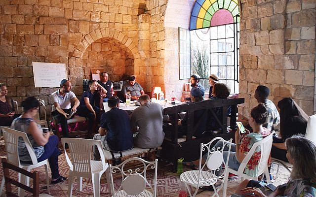 Israelis from a range of backgrounds gather for discussion in Hinam's beit midrash in an old building in Abu Ghosh as the organization works to build tolerance.