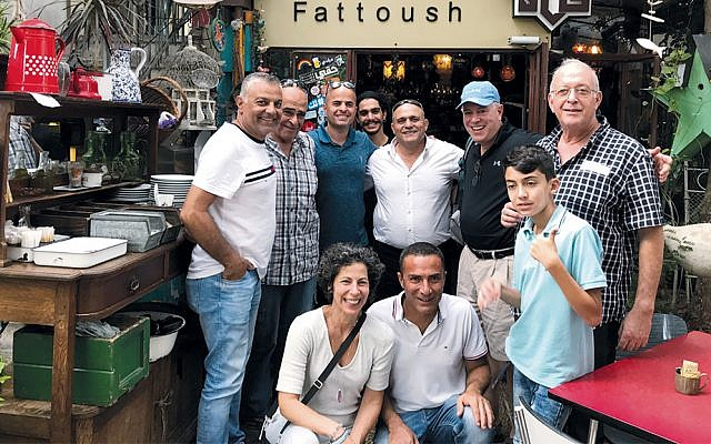 The Kornblits and members of the 2010, 2015, 2017, and 2018 delegations meet at a restaurant. Three of the Zahal Shalom alumni here are Druze.