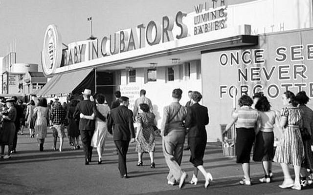 Visitors stroll past an exhibition of babies in incubators at the New York World's Fair.