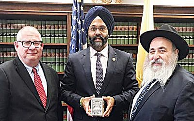 Leon Kozak of Bris Avrohom, left, with New Jersey State Attorney General Gurbir Grewal and Rabbi Mordechai Kanelsky. (Courtesy Bris Avrohom)