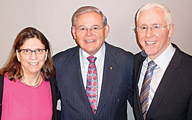 Esther and Mort Fridman flank Senator Robert Menendez. (Courtesy Norpac)