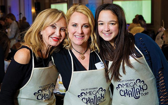 Three generations from one family bake challah together. Roberta Soltnick, left, her daughter, Shari Pillar of Woodcliff Lake, and Ms. Soltnick's granddaughter, Camryn Pillar, at Valley Chabad's Mega Challah Bake last year. (Srivki Photography)