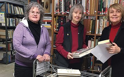 Members of the Friends of the Englewood Library sort and shelve books for the sale. (Photo provided)