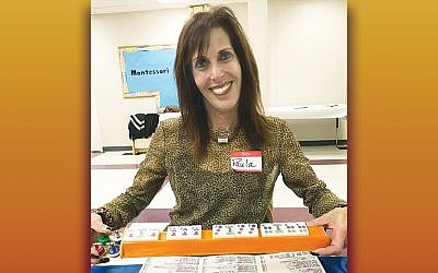 Mahjong student Paula Rindner shows her winning hand. (Courtesy TBT)