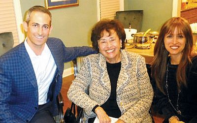 Ezra and Miriam Lightman flank Representative Nita Lowey. (Courtesy Norpac)