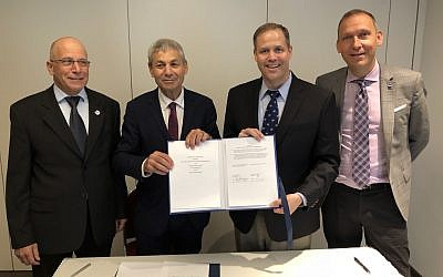 From left: Ido Anteby, CEO of SpaceIL; Avi Blasberger, director of the Israel Space Agency; and NASA officials Jim Bridenstine and Thomas Zurbuchen show the agreement between NASA and ISA to cooperatively utilize SpaceIL's planned commercial lunar mission. (NASA)