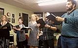 "From left, Ginger Inabinet, Sarah Baumgarten, Aimee-Rose Willett, Stephen Steffens, and William Hurwitz rehearse ""The Yellow Star."" (Bradley Detrick)"