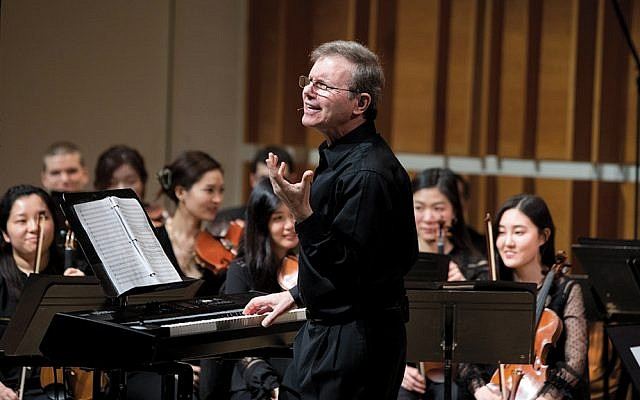Rob Kapilow teaches and conducts at the Kaufman Center in Manhattan; here, he's onstage with students. (Courtesy Kaufman Center)