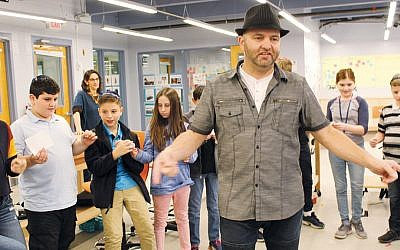 Michael Sturtz leads a workshop on creativity for middle school students at Solomon Schechter Day School in New Milford.