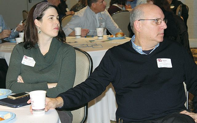 Rabbi Lindsey Healey-Pollack and Steven Haber of Congregation Kol HaNeshamah in Englewood listen as Lisa Harris Glass, the Jewish Federation of Northern New Jersey's chief planning officer, talks about collaboration.