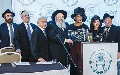 Rabbi Avremy Kanelsky, left, Tzvi Odzer, Moshe Furer, Rabbi Mordechai Kanelsky, state Lieutenant Governor Sheila Oliver, Shterney Kanelsky, and Rabbi Berele Zaltzman. (Courtesy Bris Avrohom)