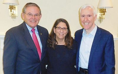 Senator Robert Menendez (D-N.J.) left, with Esther and Mort Fridman (Courtesy Norpac)